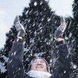 Man with arms raised feeling the snow — Stockfoto