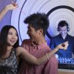 Young couple dancing in nightclub — Stock Photo