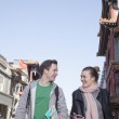 Couple sightseeing, holding map and mobile phone — Stock Photo