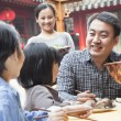 Family enjoying a traditional Chinese meal — Stock Photo