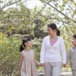 Grandmother with her two grandchildren in the park — Stock Photo