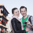Stock Photo: Young couple sightseeing