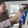 Woman going through clothes at fashion store — Stock Photo