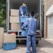Movers unloading a moving van — Stock Photo #36656945