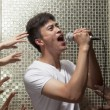 Man singing into a microphone — Stock Photo #36657277