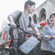 Man and woman with bicycles and map — Stock Photo