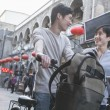 Stockfoto: Mand womwith bicycles and backpacks