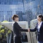 Businesswomen shaking hands outdoors — Stock Photo #36657777