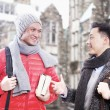 Two men in winter clothes talking — Stock Photo #36658461