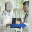 Doctors consulting over medical record — Stock Photo #36659405