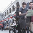 Man and woman with bicycle and map — Stock Photo