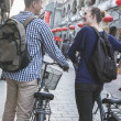 Young man and woman with bicycles — Stock Photo