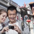 Young couple sightseeing — Stock Photo #36659923