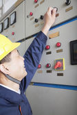 Worker checking controls in a gas plant — Stock Photo