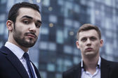 Businessmen looking at the camera, outdoors — Stock Photo