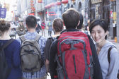 People walking down street — Stock Photo