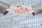 Business people shaking hands by Chinas world trade center — Stock Photo