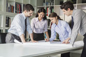 Four architects planning — Stock Photo