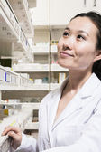 Pharmacist looking for medication — Stock Photo