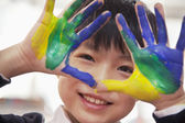 Schoolboy finger painting, close up on hands — Stock Photo