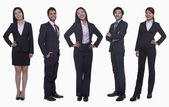 Businesswomen and young businessmen — Stock Photo