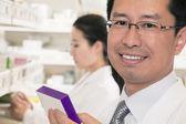 Pharmacist holding prescription medication — Stock Photo