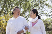 Couple going for a walk in the park — Stock Photo
