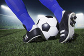 Feet kicking the soccer ball — Stock Photo