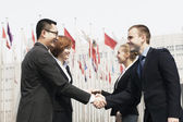 Business people meeting and shaking hands outdoors — Stock Photo