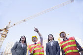 Architects and businesswomen at a construction site — Stock Photo