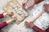 Three generation of women making dumplings — Stock Photo