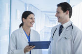 Doctors holding a medical record — Stock Photo