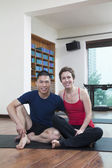 Two people relaxing in a yoga studio — Stock Photo