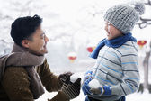 Father and son holding snowballs — Stock Photo