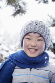 Smiling boy in the snow — Stock Photo