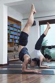 People doing yoga in a yoga studio — Stock Photo