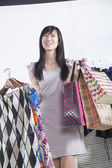 Woman with shopping bags at fashion store — Stock Photo