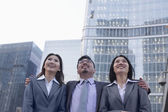 Business people in a row outdoors — Stock Photo