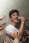 Man singing into a microphone — Stock Photo