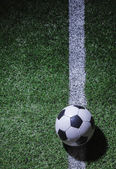 Soccer field with soccer ball and line — Stock Photo