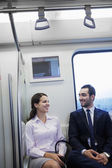 Business people chatting on the subway — Stock Photo
