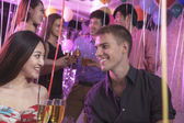Friends celebrating, toasting with champagne — Stock Photo