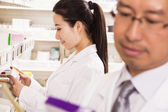 Pharmacist examining prescription medication — Stock Photo