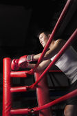 Boxer resting his elbows on the ring side — Stock Photo