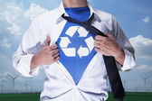 Businessman with recycling symbol underneath — Photo