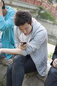 Man looking down at his phone — Stock Photo