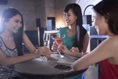 Women having drinks in a nightclub — Stock Photo