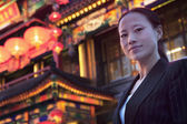 Businesswoman with Chinese architecture — Stock Photo