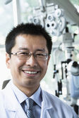 Smiling optometrist in his clinic — Stock Photo