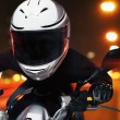 Man riding a motorcycle at night — Photo